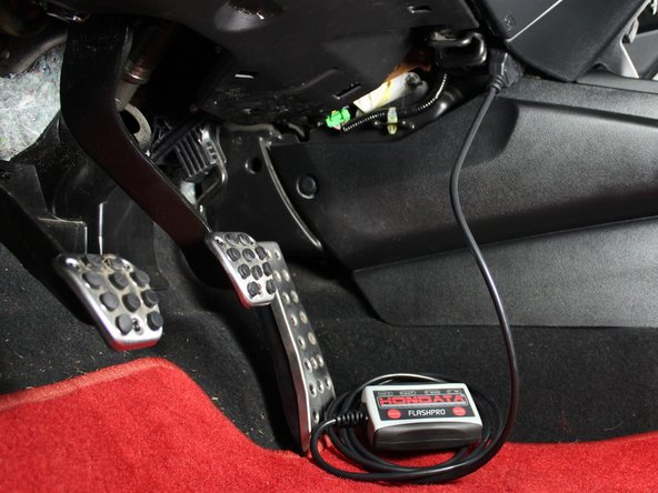 Switch on the ignition but do not start the engine. This will send the vehicle information to the Flashpro that you will need to lock the Flashpro to your ECU.